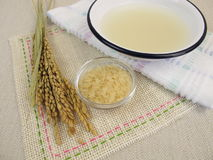 Rice water bath in a bowl Stock Photo