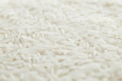 Rice, white grains closeup. Basmati. Unpolished, uncooked, natural, diet, raw for traditional asian cuisine, dish Stock Photo