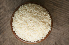 Rice. White rice in wood cup have wood table is backgruond Royalty Free Stock Images