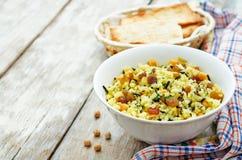 Rice, wild rice, chickpeas with raisins and herbs Stock Image