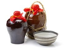 Rice wine in the ceramic jar. Isolated on white background stock photos