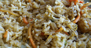 Rice. Withe rice cooked with some germinated herbs and some carrot stripes, chinese food served with mushrooms meat and shrimps Stock Images