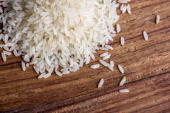 Rice on wood background Stock Photography