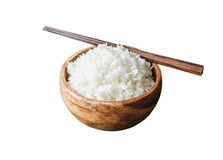 Rice in wood bowl isolated Royalty Free Stock Photography