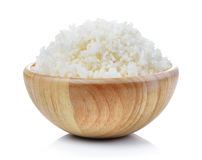 Rice in wood bowl on white background Stock Image