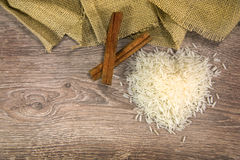 Rice on wood with cinnamon. On wood background stock photography