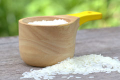 Rice in wood container Royalty Free Stock Images