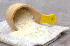 Rice in wood container Stock Photo
