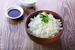 Rice  on wooden background Stock Photography