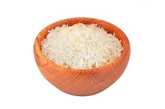 Rice in wooden bowl Stock Photos