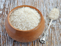 Rice in wooden bowl Stock Photography