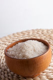 Rice in wooden bowl Stock Images