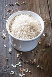 Rice in wooden bowl. White rice and in ceramic bowl on a wooden background Stock Photos