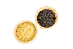 Rice in a wooden bowl isolated. Brown and wild rice in a wooden bowls on white background stock image