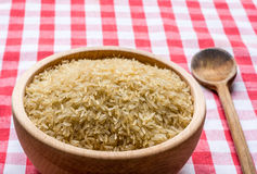Rice in a wooden bowl Stock Images
