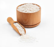 Rice in wooden bowl and spoon on white background. Stock Image