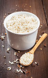 Rice in wooden bowl. White rice and in wooden bowl on a wooden background Stock Photo