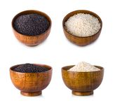 Rice in wooden bowl on white background. royalty free stock photography