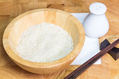 Rice in wooden bowl Royalty Free Stock Photo