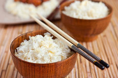 Rice in wooden bowls with chopsticks Royalty Free Stock Image