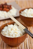 Rice in wooden bowls with chopsticks Stock Images