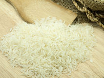 Rice. On a wooden broade Royalty Free Stock Photography