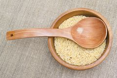 Rice in wooden plate Royalty Free Stock Photography