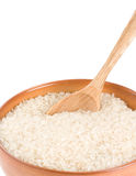 Rice in wooden plate and spoon Stock Photos