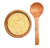 Rice in wooden plate and spoon isolated on white Royalty Free Stock Photo