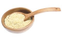 Rice in wooden plate and spoon isolated on white Stock Photography