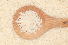 Rice on a wooden spoon Royalty Free Stock Images