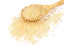 Rice in a wooden spoon Stock Photography