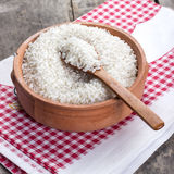 Rice on wooden spoon Stock Photos
