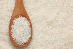 Rice in a wooden spoon Stock Photos