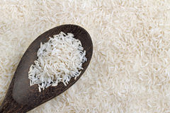 Rice on wooden spoon Stock Photo