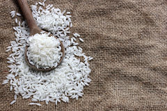 Rice in a wooden spoon Royalty Free Stock Photos