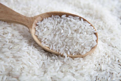 Rice in a wooden spoon Royalty Free Stock Photo