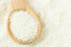 Rice on wooden spoon Royalty Free Stock Image