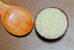 Rice in wooden spoon Stock Image