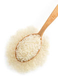 Rice in wooden spoon on white Stock Images