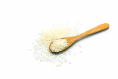 Rice in wooden spoon on white background. Heap of raw rice in wooden spoon on white background Stock Images