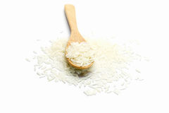 Rice in wooden spoon on white background. Heap of raw rice in wooden spoon on white background Stock Image