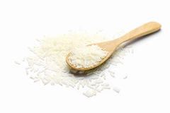 Rice in wooden spoon on white background. Heap of raw rice in wooden spoon on white background Royalty Free Stock Photography