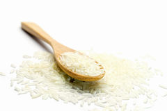 Rice in wooden spoon on white background. Heap of raw rice in wooden spoon on white background stock photo
