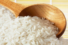Rice on wooden spoon royalty free stock images