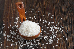 Rice in a wooden spoon Royalty Free Stock Image