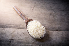 Rice on Wooden Spoons on wooden background Royalty Free Stock Photos