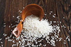 Rice on wooden table Stock Photography