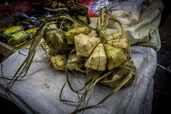 Rice wraped with coconut leaf with diamond shape on sale in traditional market Bogor Indonesia Royalty Free Stock Image