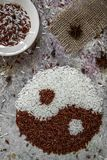 Rice yin and yang concept. Red and white rice top view stock photos
